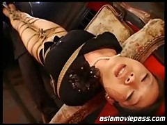 Busty japanese babe maki tomoda is tied up and whipped and abused