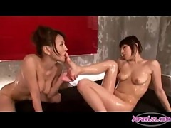 2 Asian Girls Kissing On Their Knees Rubbing Tits Sucking Tongues Nipples And Toes On The Mattress I