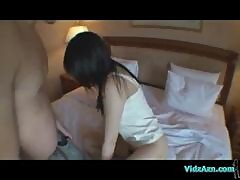 Asian Girl Sucking Guy Toes And Cock On The Bed In The Hotel Room