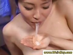 Cute Little Asian Girl Is With A Bunch Of Cocks And Blows Them