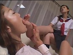 Japanese girl sucking on toes