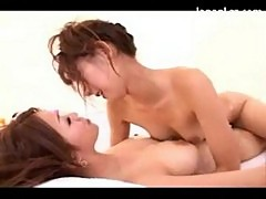 2 asian girls with oiled bodies rubbing bodies sucking toes