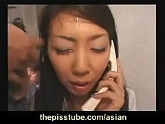 Japanese office slut licks cum from a desk after bukkake