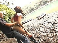 Asian babe Erika fucked by lake by a stiff cock doggie-style